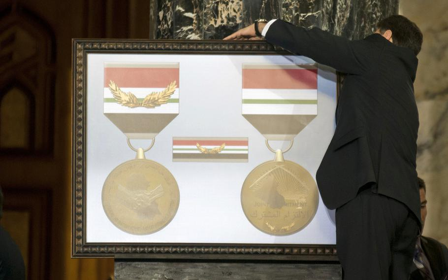 The Iraq Commitment Medal is unveiled during a ceremony in Baghdad on Dec. 1, 2011.
