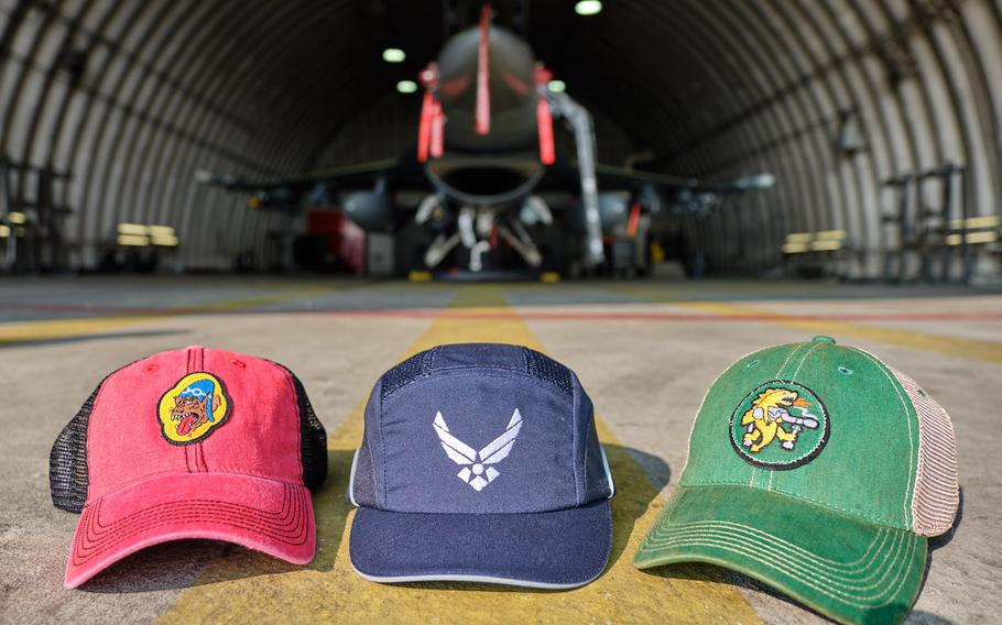 Two squadron bump caps are displayed alongside a prototype Air Force bump cap at Osan Air Base, South Korea, Wednesday, Aug. 28, 2019.