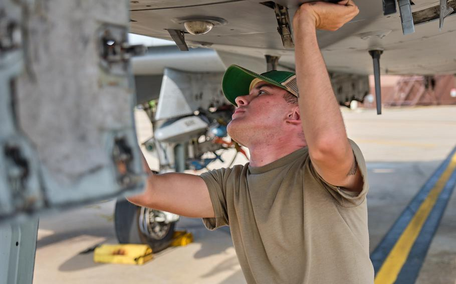 Airman 1st Class Chrisdien Scarlett, a crew chief with the 25th Aircraft Maintenance Unit, wears a bump cap as he inspects an A-10 Thunderbolt II at Osan Air Base, South Korea, Wednesday, Aug. 28, 2019.