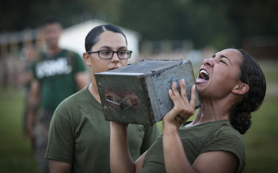 An officer candidate lifts an ammo can during a combat fitness test at Marine Corps Base Quantico, Va., July 16, 2019.