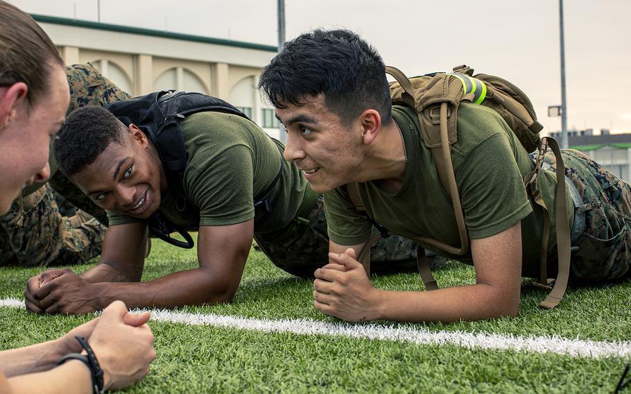 Marines perform planks during physical training at Marine Corps Air Station Iwakuni, Japan, July 26, 2019.