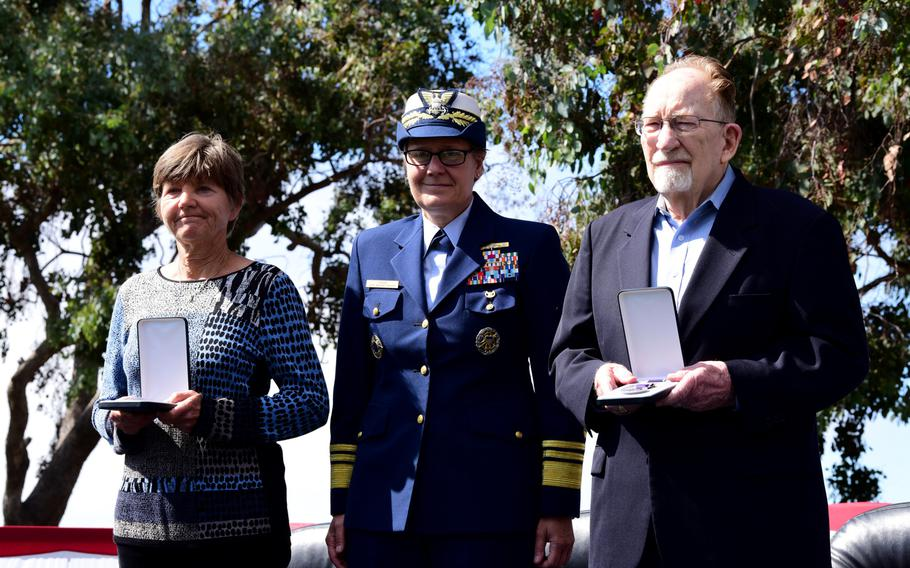 Coast Guard Vice Adm. Linda Fagan, Pacific area commander (center) stands with Lisa Rehman and Bob Kelleher, who accepted Purple Heart medals on behalf of family members killed in World War I, during a ceremony on Coast Guard Island in Alameda, Calif., Sept. 3, 2019.