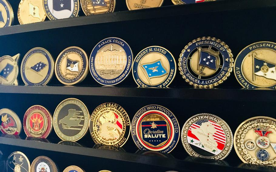 A display case features command and flag officer coins on August 28, 2019. The origin of commanders presenting coins to deserving sailors is disputed, but some historians think the tradition in U.S. history stems from the U.S. Civil War.
