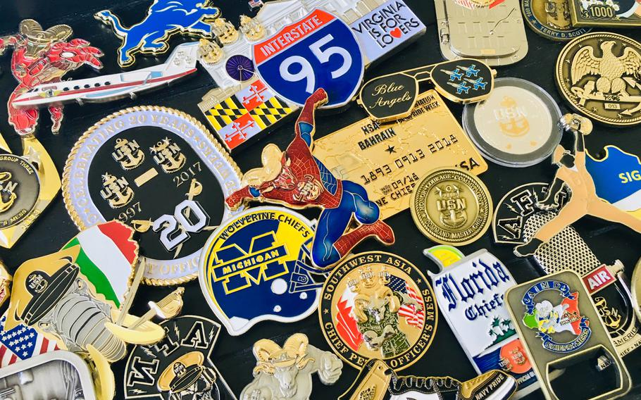 A collection of chief petty officer coins is displayed on August 28, 2019. The tradition of challenge coins within the chief?s mess has seen an increase in production and creativity since the late 1990s when the practice was generally reserved for senior leadership.