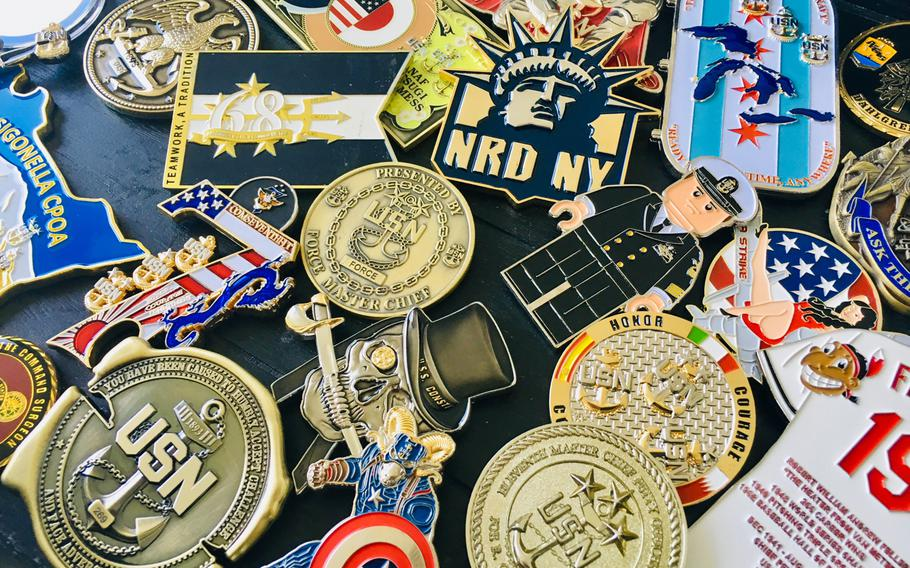 A collection of chief petty officer coins is displayed on August 28, 2019. The tradition of challenge coins within the chief's mess has seen an increase in production and creativity since the late 1990s when the practice was generally reserved for senior leadership.