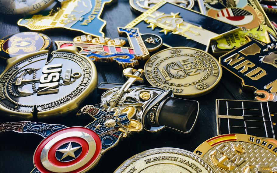 A collection of chief petty officer coins is displayed on August 28, 2019.