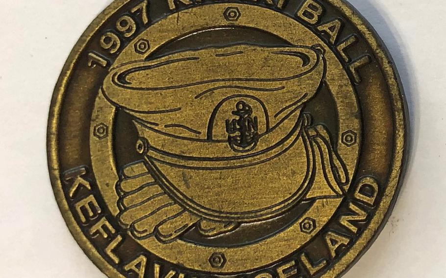 A khaki ball coin from 1997 was designed by retired Master Chief Petty Officer Martin Kidder for his chief petty officer mess in Keflavik, Iceland. Kidder, who now owns a coin company specializing in chief coins, said this coin was the first one he saw during his career.