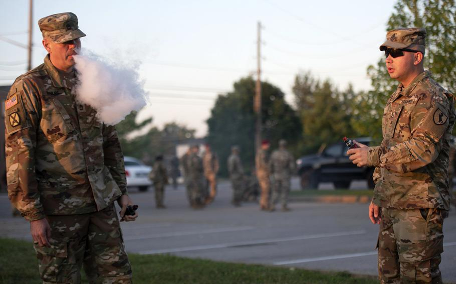 Sgt. 1st Class Bryson Briles, left, and Staff Sgt. Jorge Flechas enjoy a relaxing moment vaping before heading to class at U.S. Army Recruiting and Retention College Sept. 5, 2019. Briles said he vapes as a safer alternative to cigarettes. Flechas said he vapes for recreational purposes. Health officials say they suspect the more than 200 recent deaths and serious illnesses across a 25-state area in the United States are the result of vaping.