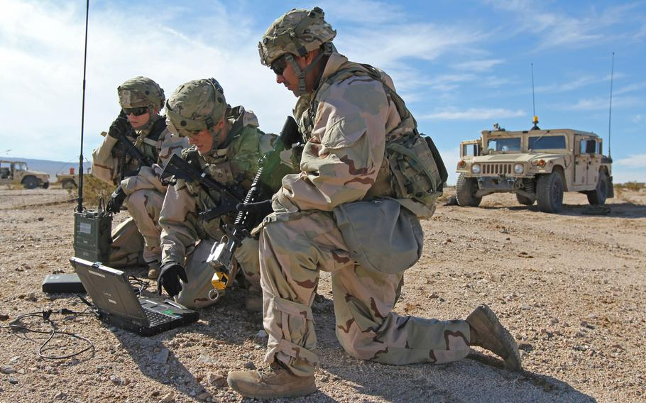 Cyberspace operations soldiers, from left, Spc. Ashley Lethrud-Adams, Pfc. Kleeman Avery and Sgt. Alexander Lecea, 782nd Military Intelligence Battalion, provide cyberspace operations support while training at the National Training Center, Fort Irwin, Calif., Jan. 13, 2019.