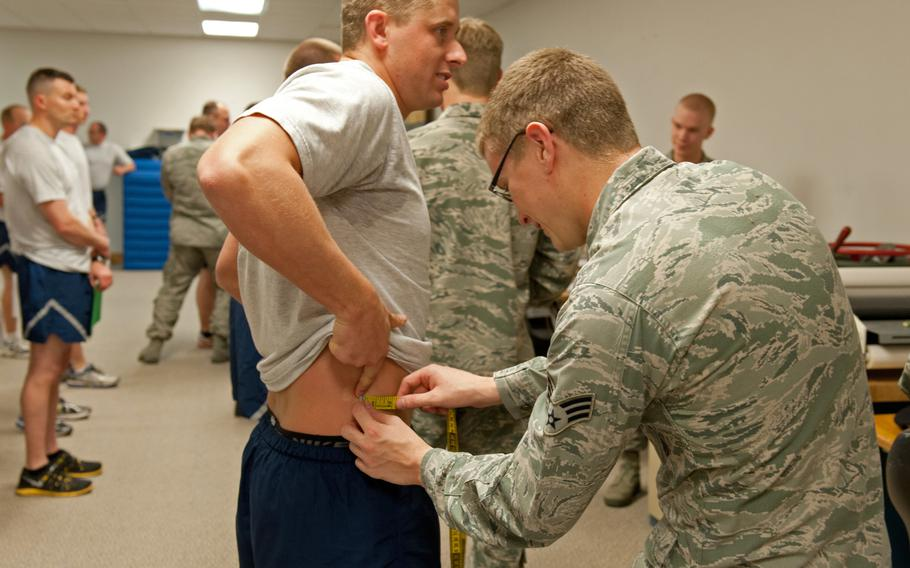 Senior Airman Chris Barrier from the 124th Security Forces Squadron gets his waist measured during his annual fitness assessment in Apr. 2015. The Air Force is considering administering the abdominal circumference test at a separate time from the rest of the physical fitness assessment.