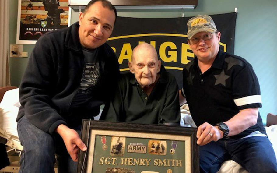 On his 98th birthday, Silver Star recipient Henry C. Smith poses with former Army Rangers Jose Mortenson, left, and Wes Goldman in Traverse City, Mich., May 20, 2019. Smith died on Aug. 5.