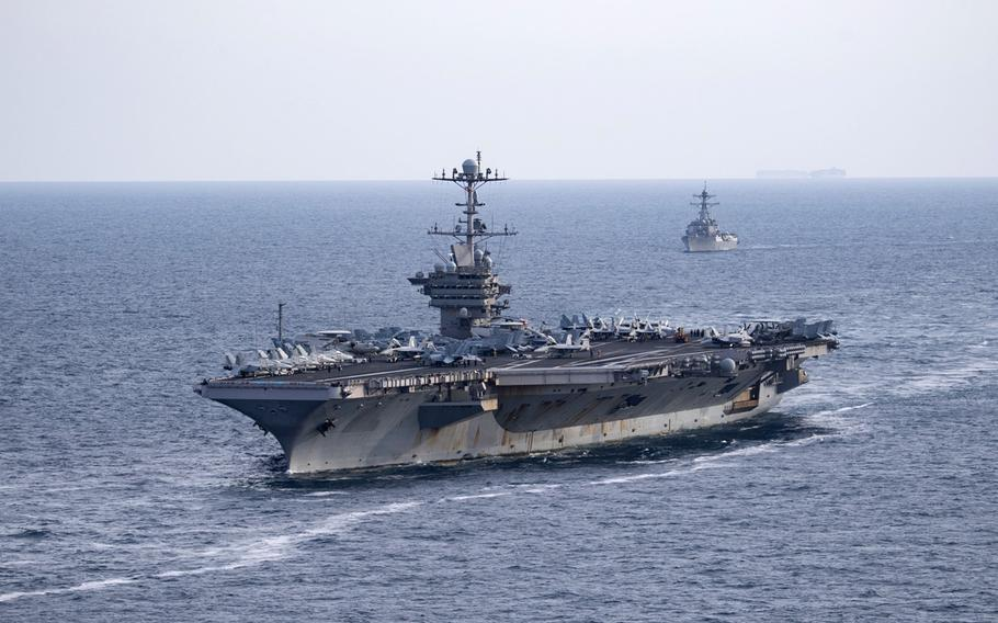 The aircraft carrier USS Harry S. Truman, front, and the guided-missile destroyer USS Lassen transit the Atlantic Ocean, July 18, 2019. The Truman's strike group has deployed while the ship remains docked, undergoing repairs on an electrical system that malfunctioned three weeks ago.
