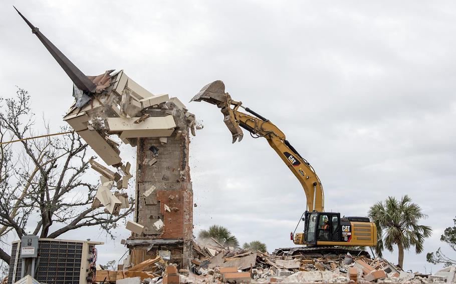 A construction crew demolishes the steeple at Chapel 2 at Tyndall Air Force Base, Fla., Feb. 15, 2019, after it was damaged by Hurricane Michael four months earlier.