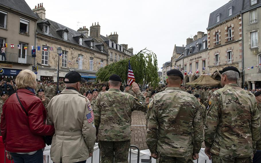 Army Chief of Staff Gen. Mark Milley renders the oath of enlistment to 21 soldiers during the 101st Airborne Division re-enlistment ceremony in Carentan, France, June 7, 2019, as part of the commemoration of the 75th anniversary of D-Day.