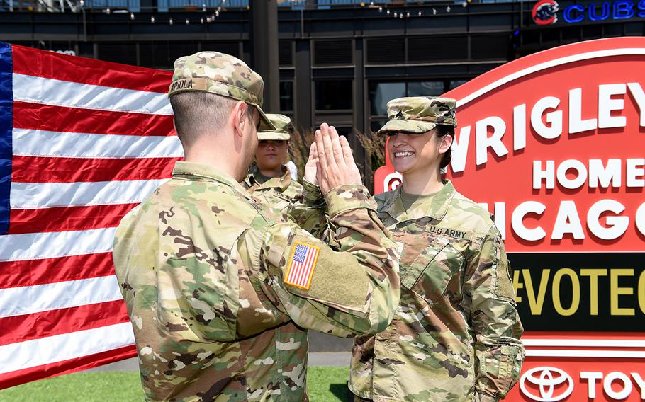 Sgt. Maribel Meraz, assigned to the 85th U.S. Army Reserve Support Command in Chicago, re-enlists at Gallagher Way, adjacent to the Chicago Cubs' Wrigley Field, June 27, 2019, to begin her third six-year stint in the Reserves.