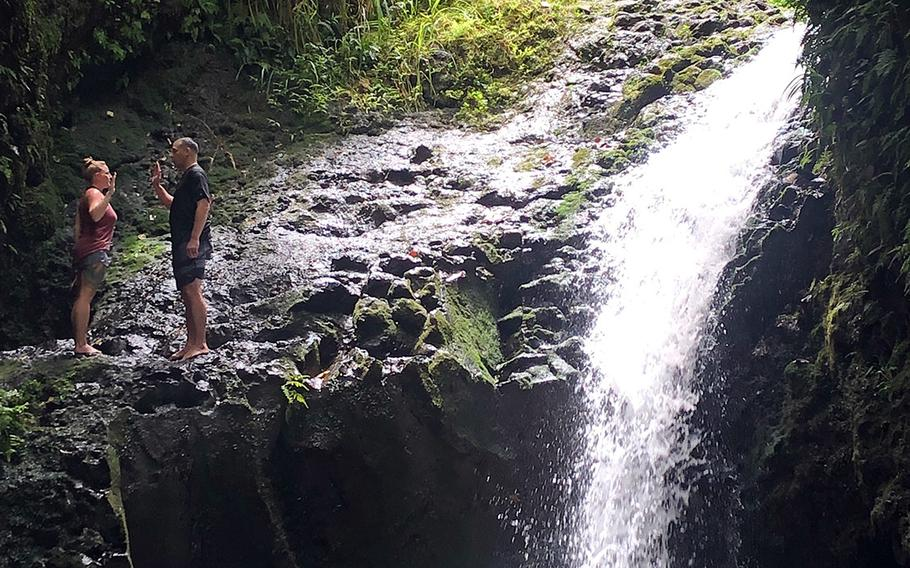 Petty Officer 2nd Class Emily Braswell, an electronics technician assigned to the Center for Surface Combat Systems Detachment Pearl Harbor, re-enlists above Maunawili Falls, near Honolulu, Hawaii, May 19, 2019.
