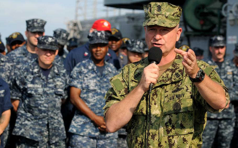 Then-Master Chief Petty Officer of the Navy Rick West holds an all-hands call at Naval Station Norfolk, Va. West is wearing the Navy working uniform type III during a test phase, while the sailors behind him wear the Type I uniform. That uniform, also known as a blueberry, will no longer be authorized for wear starting October 1, 2019.