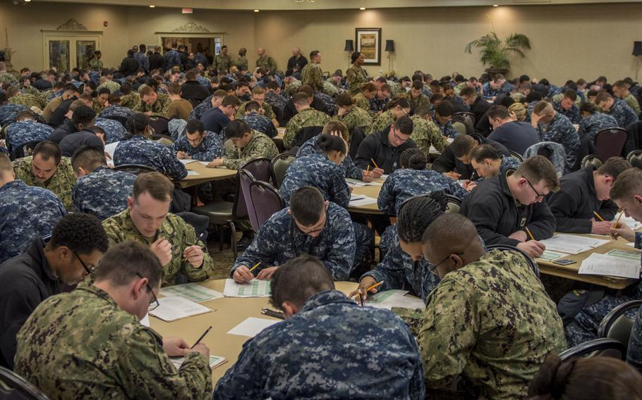 Sailors assigned to the aircraft carrier USS George H.W. Bush take the Navy-wide advancement exam at Norfolk Naval Shipyard, Va. in March 2019.  Some are wearing the type I uniform, also known as the blueberry because of its coloring, which will no longer be authorized for wear starting October 1, 2019.