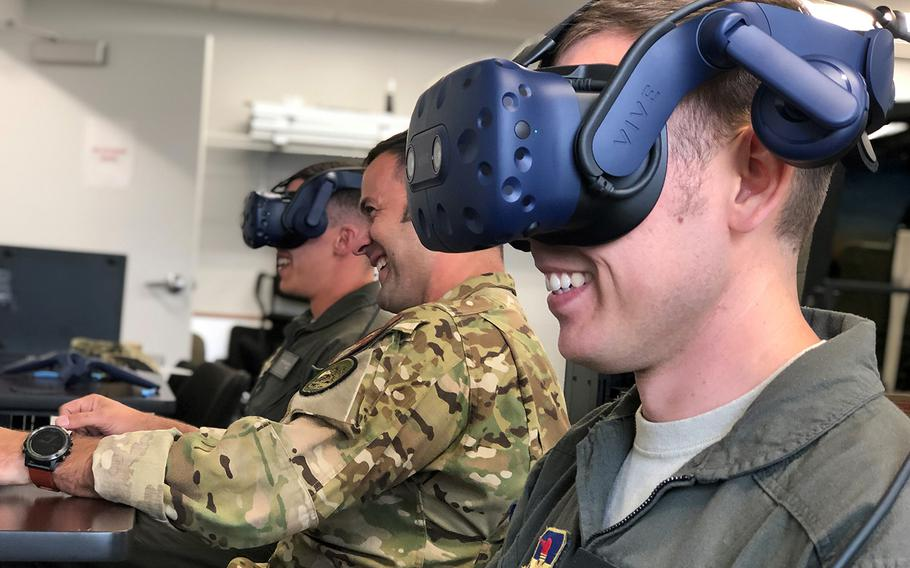 Air Force student-pilots work with an instructor from the 23rd Flying Training Squadron during a virtual reality simulator sortie, Oct. 9, 2019, at Fort. Rucker, Ala.