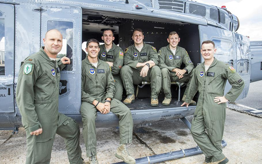 Air Force officers pose with a TH-1H helicopter at Fort Rucker, Ala., Oct. 10, 2019, after graduating from a pilot training program that tested virtual reality simulators and a new, shorter curriculum. They are, from left, 2nd Lt. Trent Badger, 2nd Lt. J. Karl Bossard, 1st Lt. Matthew Gulotta, 2nd Lt. John Thrash, Capt. Josh Park and 2nd Lt. Richard Songster.