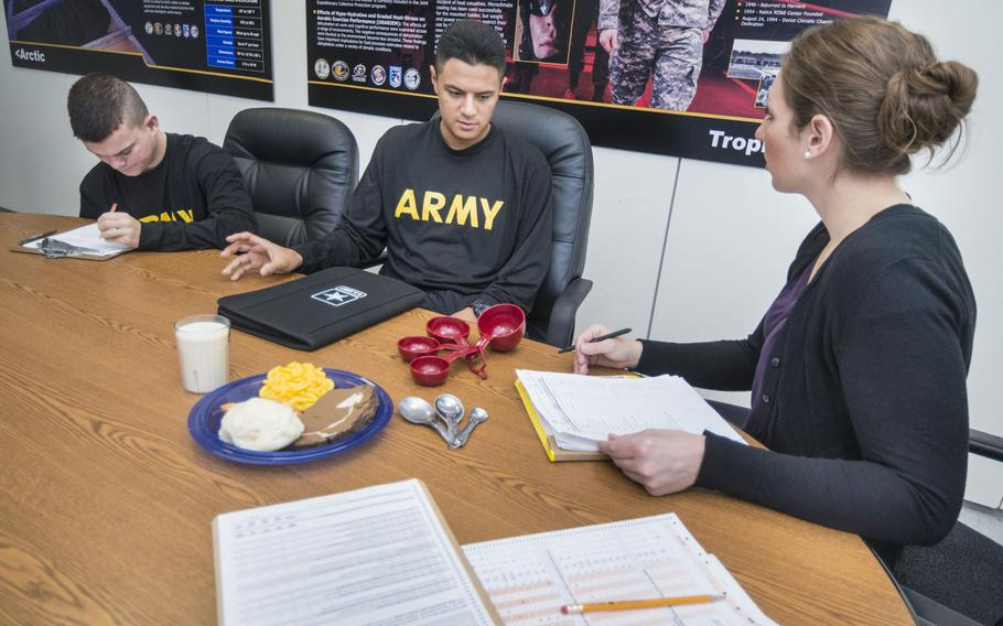 Adrienne Hatch, right, a research dietitian from the U.S. Army Research Institute of Environmental Medicine, administers a questionnaire with two volunteers taking part in a study to see how military rations affected soldiers' gut health.