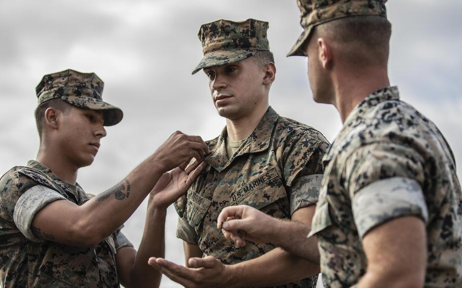 U.S. Marine Corps Cpl. Alexander Alfaro, a field artillery cannoneer assigned to 1st Battalion 11th Marines, 1st Marine Division, receives a Navy and Marine Corps Achievement Medal after being promoted to the rank of corporal at Marine Corps Base Camp Pendleton, September 26, 2019. The Corps is changing eligibility for promotion to sergeant and staff sergeant.