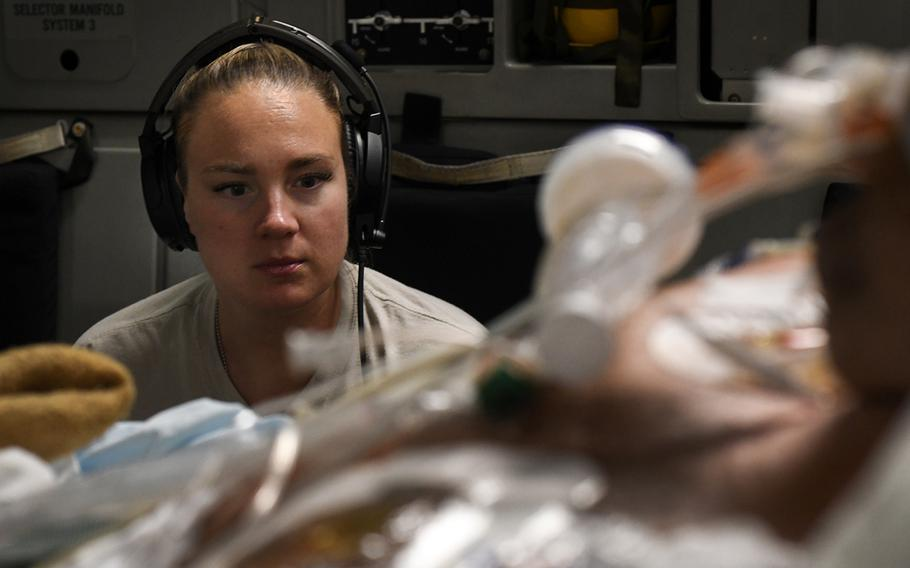 Capt. Natasha Cardinal, a critical care nurse for the 86th Aeromedical Evacuation Squadron at Ramstein Air Base, Germany, monitors a patient during a nonstop flight from Bagram Airfield, Afghanistan, to San Antonio, Texas, Aug. 18, 2019.