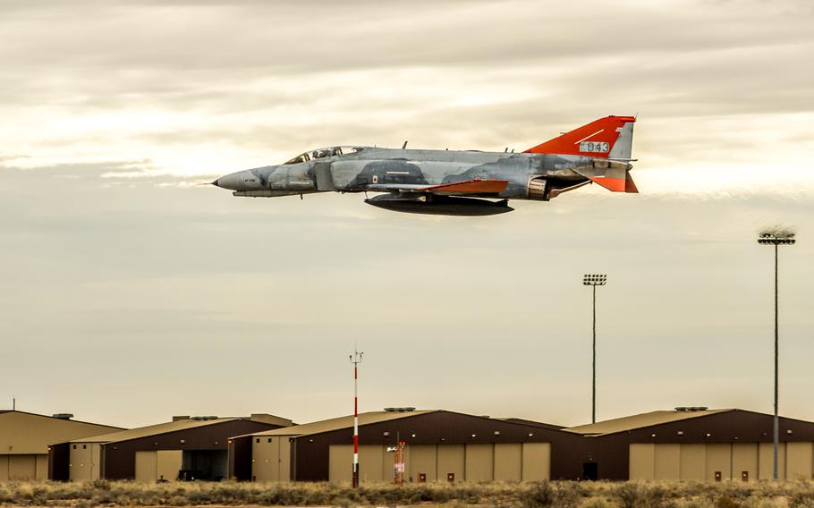A McDonnell Douglas QF-4 Phantom II of the 82nd Aerial Target Squadron Detachment 1 flies over the flight line during the final flight ceremony for the storied aircraft at Holloman AFB, N.M., Dec. 21, 2016.