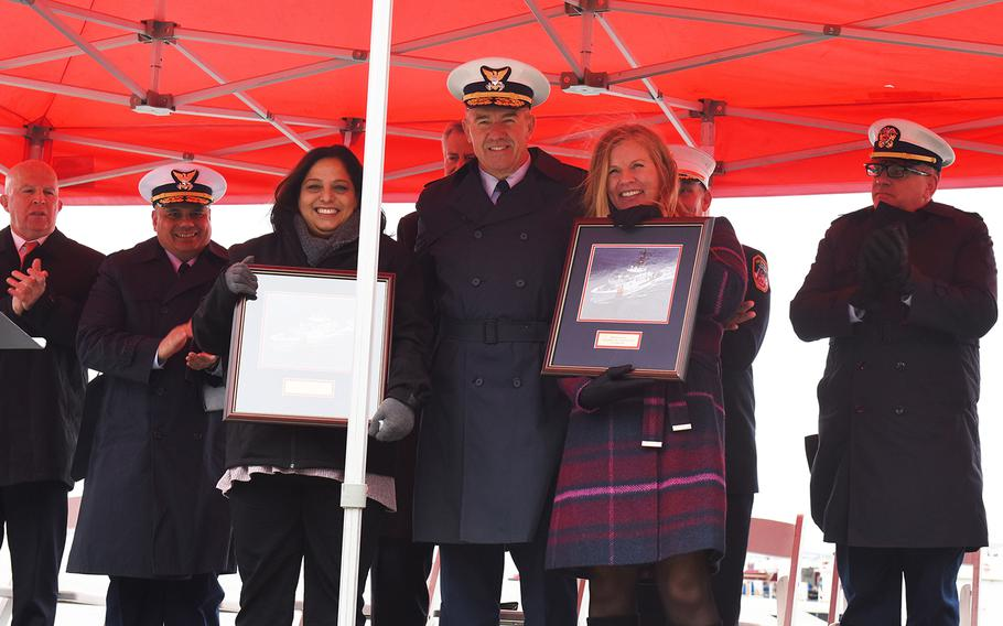 Lisa Palazzo, left, and Angela Danz-Donahue pose with Coast Guard commandant Adm. Karl Schultz after two cutters were named after their late husbands in New York, N.Y., Tuesday, Nov. 12, 2019. Jeffrey Palazzo and Vincent Danz were Coast Guard Reservists who died responding to the Sept. 11, 2001, attacks on the World Trade Center.