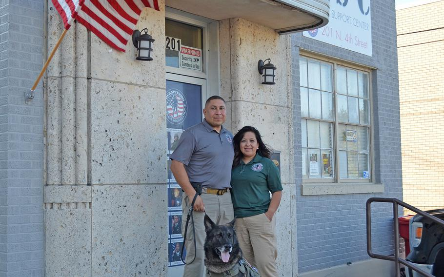 Le Roy Torres stands outside the Burn Pits 360 Warrior Support Center in Robstown, Texas, alongside his wife Rosie Torres and his service dog Hope. Founded in 2010, the nonprofit helped create a national registry for burn pit exposure at the Department of Veterans Affairs and continues to advocate for better care for toxic exposure.