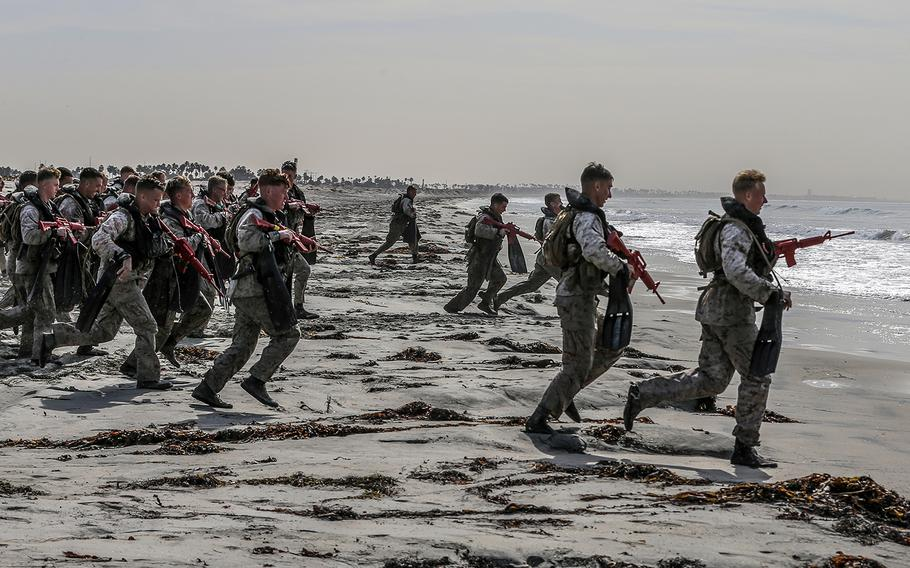 Marines taking part in the basic reconnaissance course run into the ocean at Naval Amphibious Base Coronado, Calif., Oct. 30, 2019.