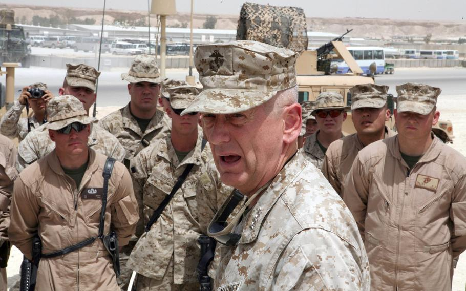 Then-Lt. Gen. Jim Mattis speaks to Marines in Al Asad, Iraq in 2007. A Marine private first class once ''hacked''  the general's computer to send an email from the account to a woman the young enlisted man had a crush on, Mattis told a crowd at a regional Chamber of Commerce luncheon.