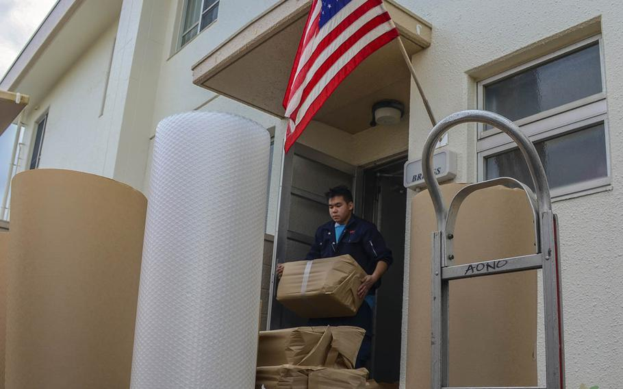 A mover takes a family's possessions from base housing at Yokosuka Naval Base, Japan, on Nov. 13, 2019.