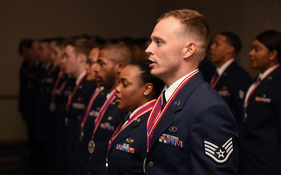 Staff Sgt. Justin Wilson, Airman Leadership School graduate of Class 18-B, recites the Airman's Creed with his fellow class graduates at Vandenberg Air Force Base, Calif., Feb. 8, 2018.