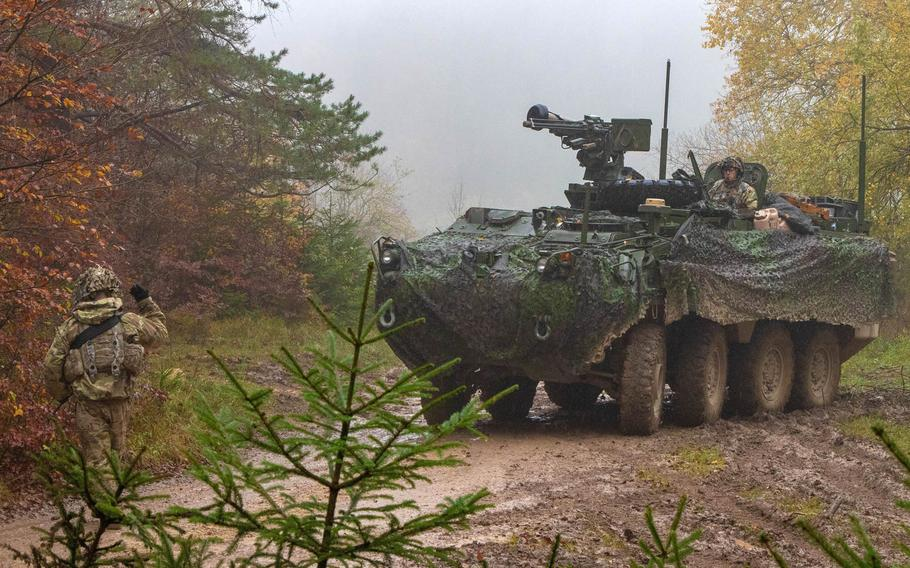 Soldiers with the 2nd Cavalry Regiment prepare to conceal a Stryker vehicle during Dragoon Ready exercise in Hohenfels, Germany, Nov. 3, 2019. The regiment will soon be heading to Poland in support of NATO's mission to deter Russia.
