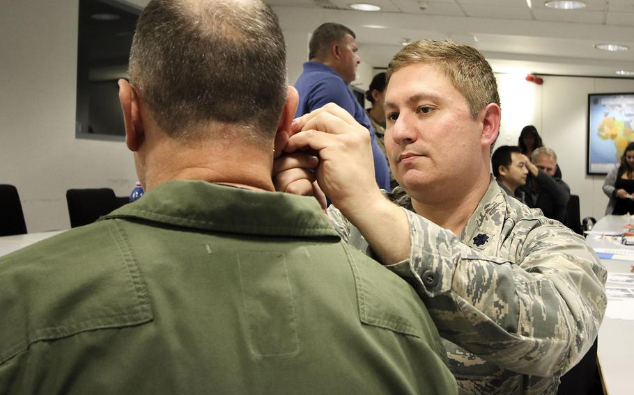Lt. Col. James Cox, an Air Force doctor, practices acupuncture as a form of pain management for traumatic brain injury at Landstuhl Regional Medical Center, Ramstein Air Base, Germany, Sept. 6, 2019.