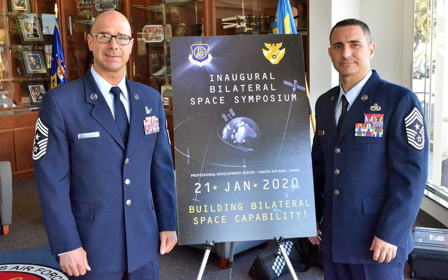 Chief Master Sgt. John Bentivegna, left, senior noncommissioned officer for Combined Force Space Component Command and Space Operations Command, poses with Chief Master Sgt. Brian Kruzelnick, the 5th Air Force command chief, during a Space Symposium on Yokota Air Base, Japan, Tuesday, Jan. 21, 2020.
