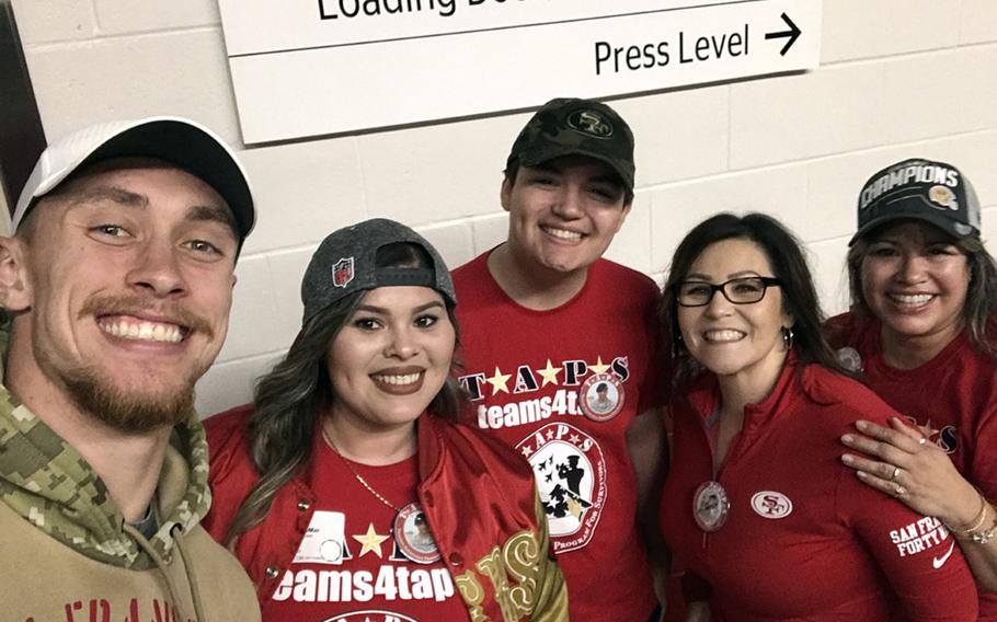 George Kittle, left, a tight end for the San Francisco 49ers, meets Jan. 24, 2020, with the family of Mick LaMar, a soldier who was killed in Iraq in 2011. Kittle met with, from left, Alexis, Nicolas and their mother, Josie LaMar, as well as a family friend, as part of a program that gave service members and families a trip to the big game.