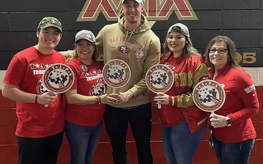 George Kittle, tight end for the San Francisco 49ers, meets  Jan. 24, 2020, with the family of Mick LaMar, a soldier who was killed in Iraq in 2011. Kittle, center, met Nicolas, Josie, and Alexis LaMar, as well as a family friend, as part of a program that gave service members and families a trip to the big game.