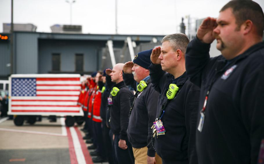 The Metropolitan Washington Fire Rescue Team honors the remains of Lt. Col. Paul C. Hudson at his repatriation ceremony, Dulles International Airport, Sterling Va., Feb. 5, 2020. Hudson was one of the three Americans killed when their C-130 Hercules Aerial Water Tanker crashed while battling wildfires in Australia.