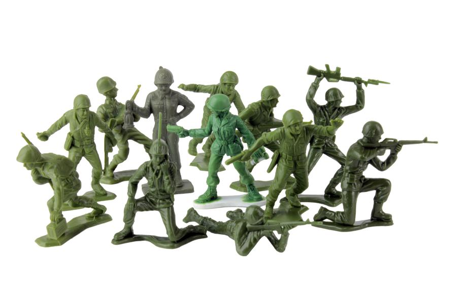 Pictured in the center of a variety of little green plastic Army men is an early sculpt of the female ''Pathfinder captain'' figure, brighter green, developed by to be released with a line of roughly 1:32-scale female soldiers.