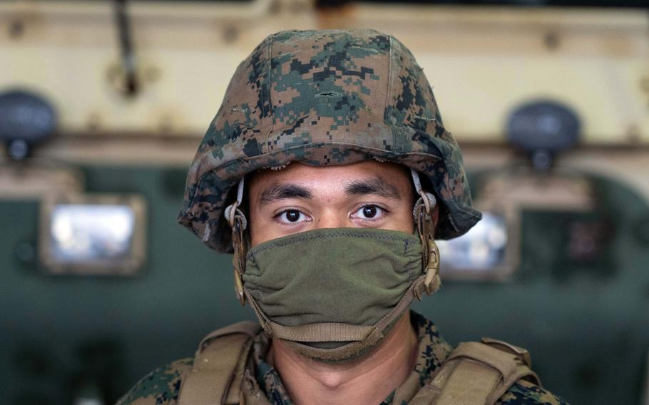 Marine Lance Cpl. Michael Ottinger wears a homemade face covering while posing for a photo on Camp Foster, Okinawa, Japan, April 7, 2020.
