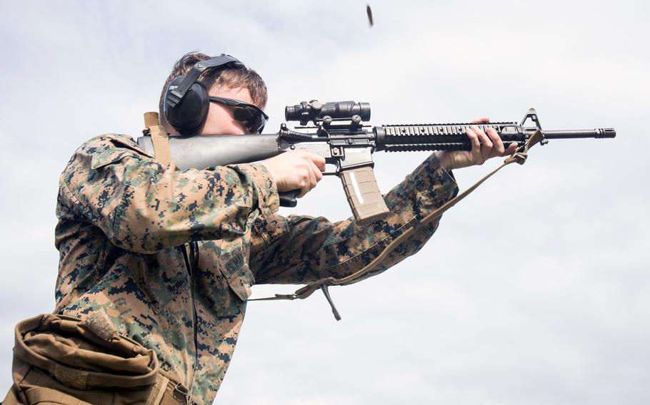 A Marine fires an M16A4 rifle during training at Marine Corps Air Station Cherry Point, North Carolina, March 13, 2020. Colt and FN America will compete for a $383 million contract to supply M16A4 rifles to Afghanistan, Grenada, Iraq, Lebanon and Nepal, the Pentagon announced.