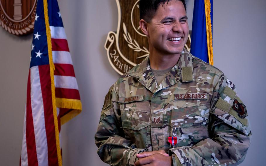 Staff Sgt. Johnathan Randall, Special Operations Surgical Team member assigned to the 720th Operational Support Squadron, smiles during a ceremony at Hurlburt Field, Florida, May 20, 2020, where he received the Bronze Star Medal for his actions while deployed in 2019.