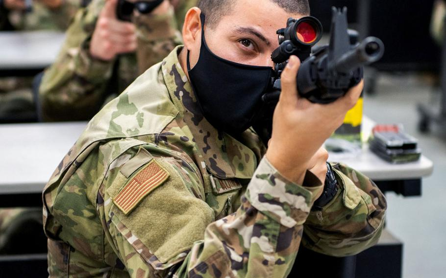 Airman Norman Enrique Muniz Vaquer attends weapon training June 9, 2020, at Joint Base San Antonio-Chapman Annex, Texas. Muniz Vaquer was taking part in the Air Force's Echo Flight program, which provides English language and cultural immersion before basic training.