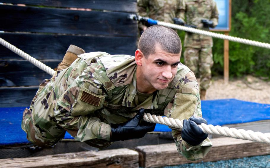 Alexie Delgado Berrios goes through the Leadership Reaction Course June 9, 2020, at Joint Base San Antonio-Chapman Annex, Texas. Delgado Berrios was taking part in the Air Force's Echo Flight program, which provides English language and cultural immersion before basic training.