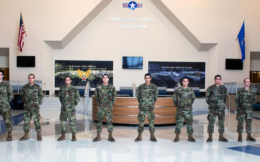 The first 10 airmen to complete an Air Force program that provides language and cultural immersion before basic training, pose for a group photo before their graduation ceremony June 18, 2020, at Joint Base San Antonio-Lackland, Texas.