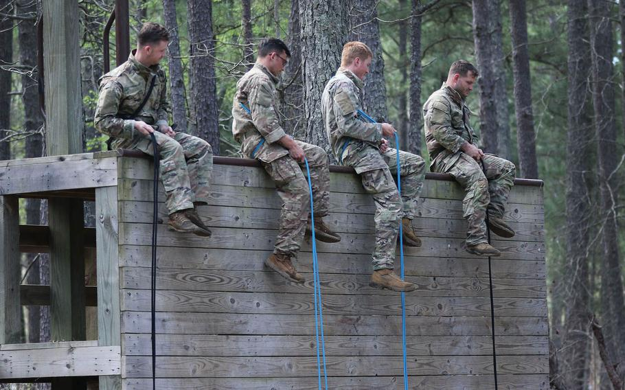 Students from the U.S. Army John F. Kennedy Special Warfare Center and School prepare to friction-rappel down a wall during the evasion phase of Survival, Evasion, Resistance and Escape Level-C training at Camp Mackall, N.C., March 21, 2020. More than 100 troops participating in the present course have been quarantined this week, after nearly most of them tested positive for COVID-19.