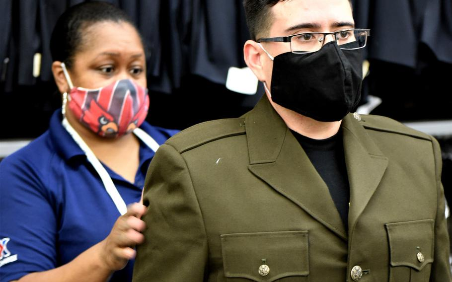 A Fort Knox, Ky., AAFES employee checks the fit of a new Army Green Service Uniform coat on a student recruiter on July 8, 2020. The recruiting students, who are about to graduate from the Army Recruiter Course at the installation, are some of the first to receive the World War II-style uniforms.
