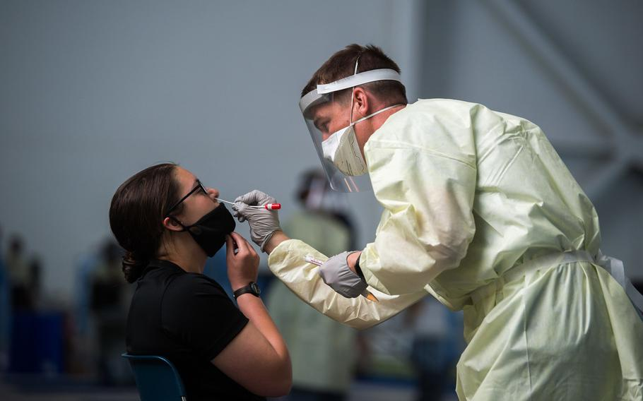 A basic cadet is tested for the coronavirus after arriving at the U.S. Air Force Academy in Colorado Springs, Colo., on June 25, 2020. Despite the academy taking numerous precautions to stem the spread of the virus, an unspecified number of cadets tested positive for it, officials said a week after classes began on Aug. 12.